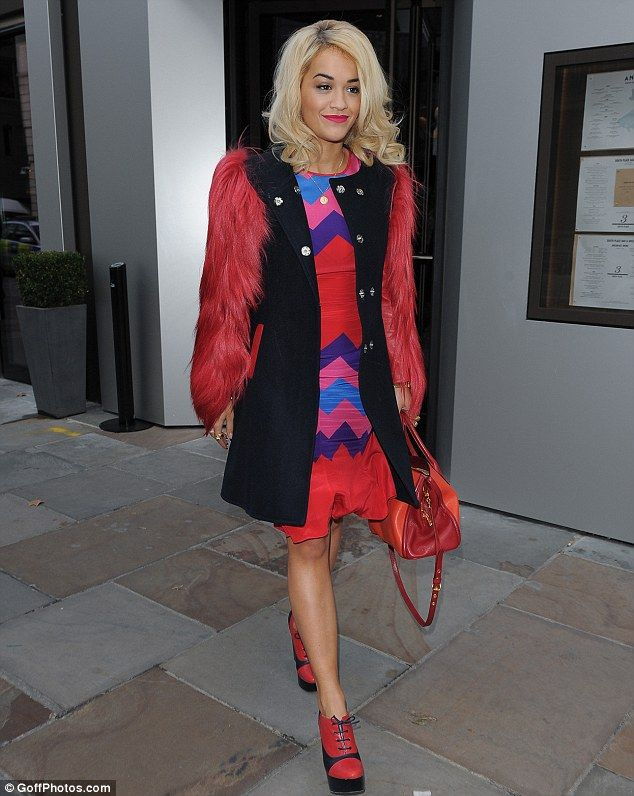 Rita Ora in sweatshirt and silver pleated skirt combo as