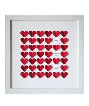 3-D Heart Art  This handcrafted, framed shadowbox will constantly remind Mom that her home is where your heart is. Recessed behind glass, the red hearts will be printed with the song lyrics of your choice, while the white ones (add up to three) can be customized with a poem, song lyrics, or a personal message.