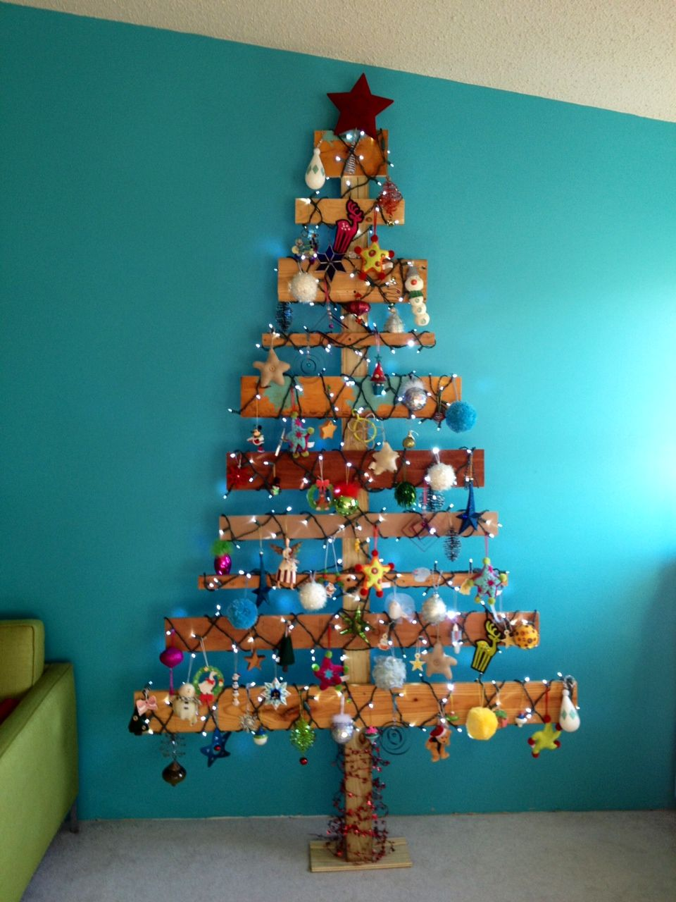 Our Christmas tree. Made from repurposed wood found in our garage. $0