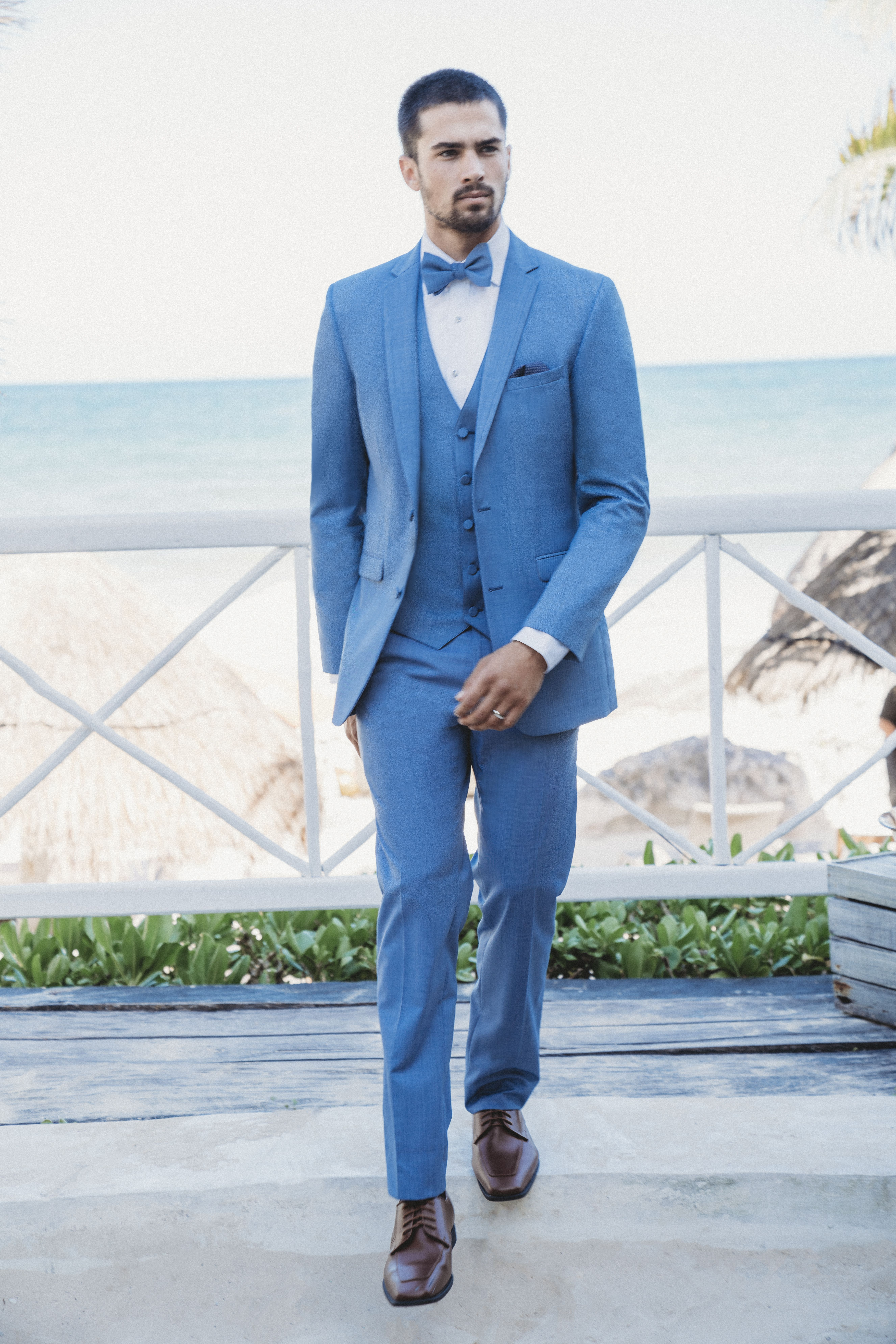 A fun light blue colored suit for your summer wedding! The