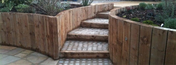 curved wood retaining walls tranquil earth building gardens with railway sleepers - Garden Design Using Railway Sleepers