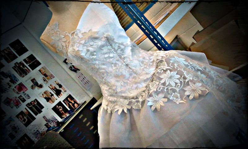 My final major dress for Uni.  Inspired by ice crystals and the frozen planet.  Watermark taffeta corset, 50's skirt made of net and chiffon and a separate lace sash which drapes around the bodice and pops at one side.