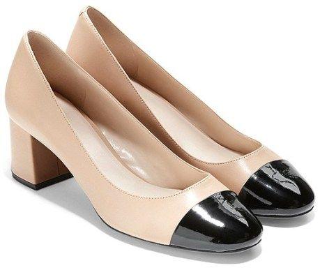 beige pumps with black toe