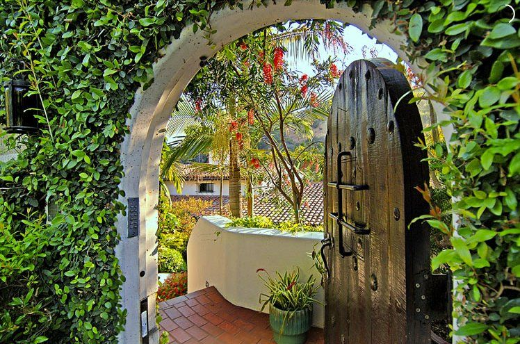 An arched doorway leads to the home.