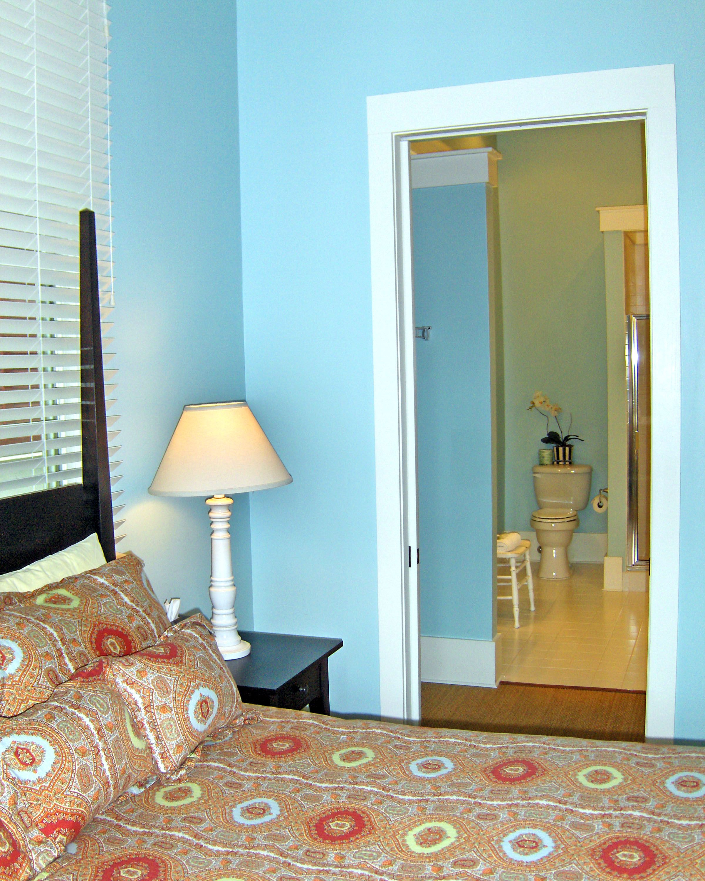 Master bathrooms are accessed by walk through closets that can be ...