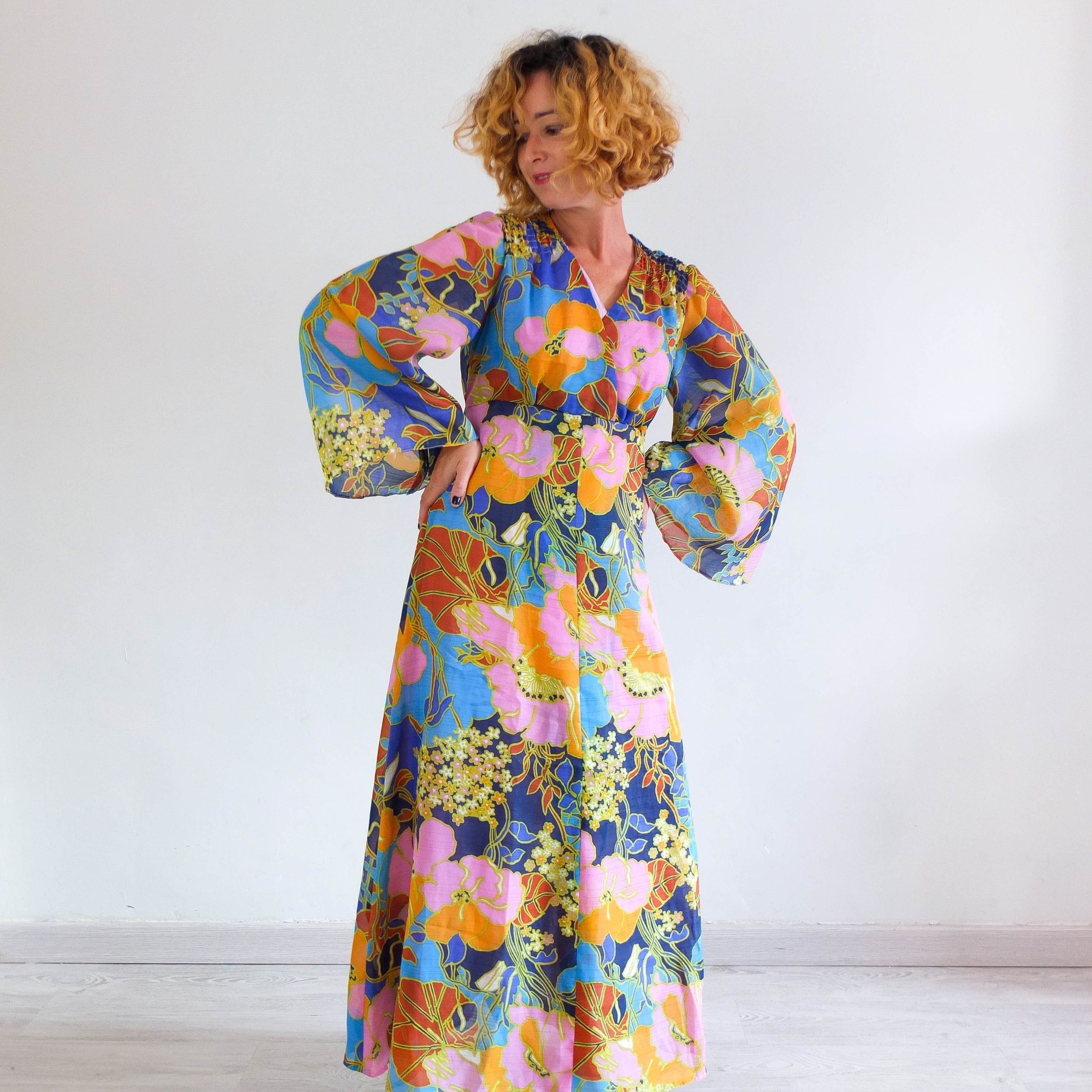Vintage Blue maxidress with flutter sleeves and novelty print