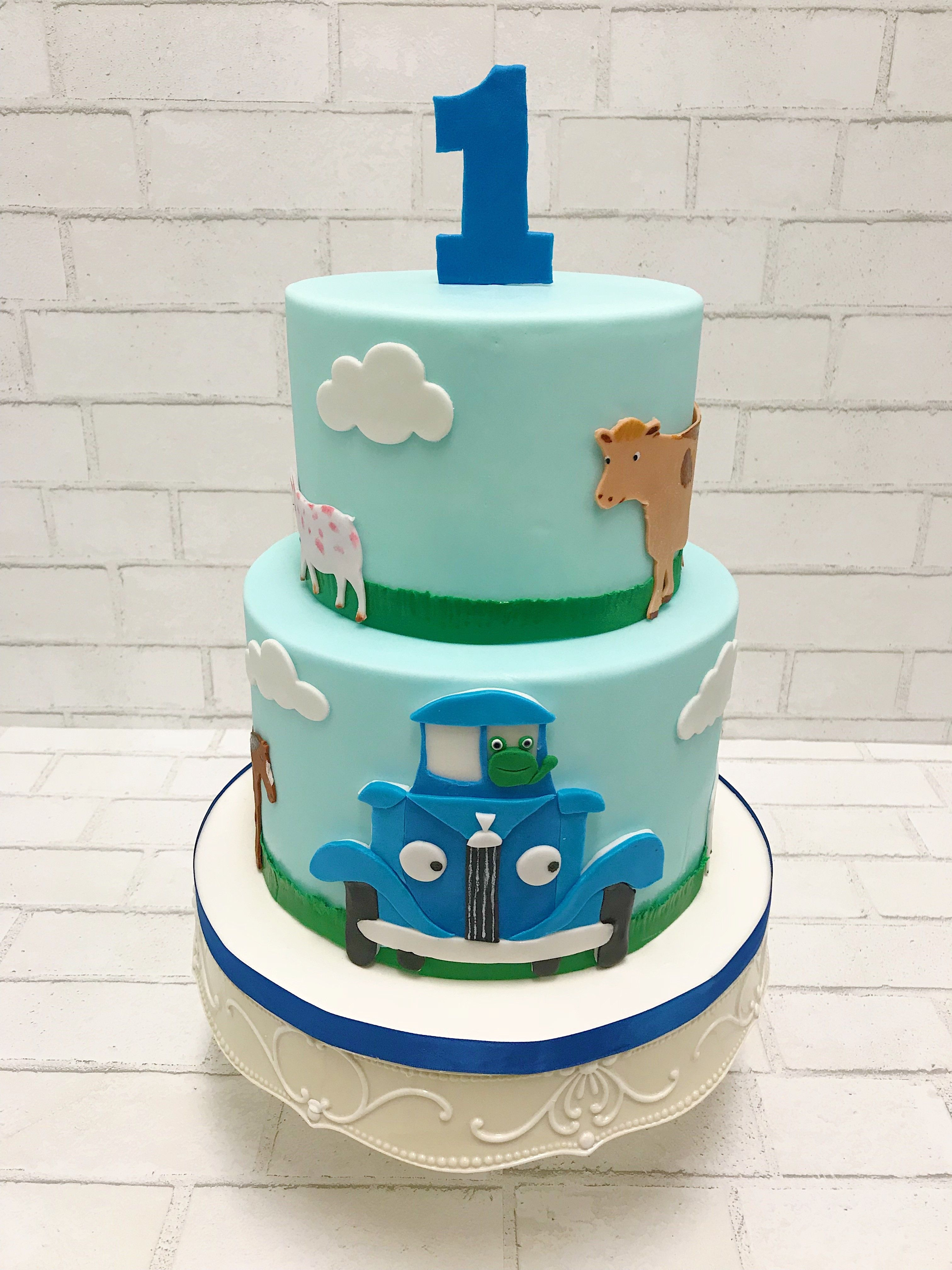 How sweet is this little blue truck 1st birthday cake