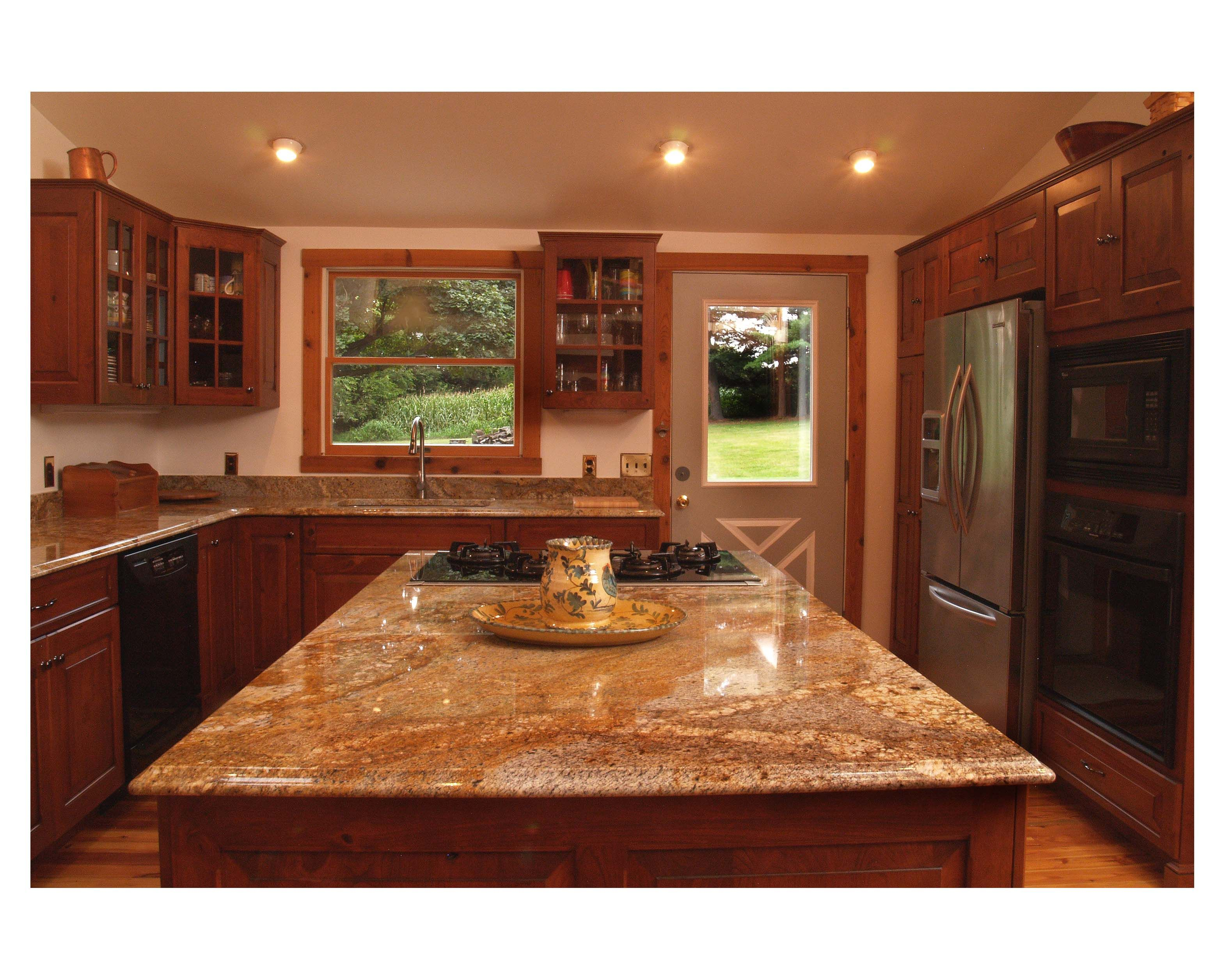 Log cabin style with modern comforts yes please cabinets for Log cabin kitchen countertops