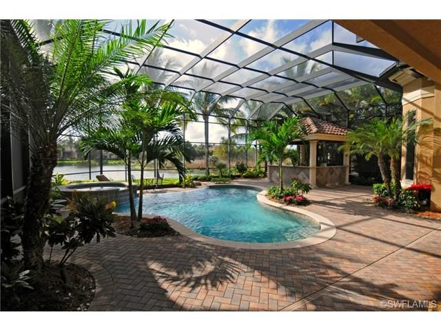 Fun pool spa and covered outdoor bar kitchen area for Pool design naples fl