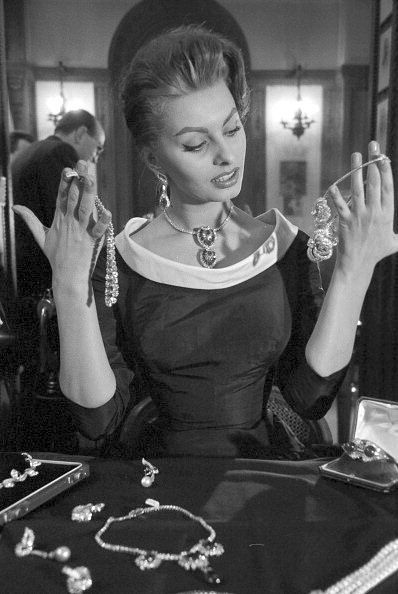 Sophia Loren at the Cartier jewelry store in Paris, photo by Jack Garofalo, 1956 is part of Sophia loren, Sophia loren images, Sofia loren, Sophia, Celebrities, Celebrity jewelry - Paris Match via Getty Images)