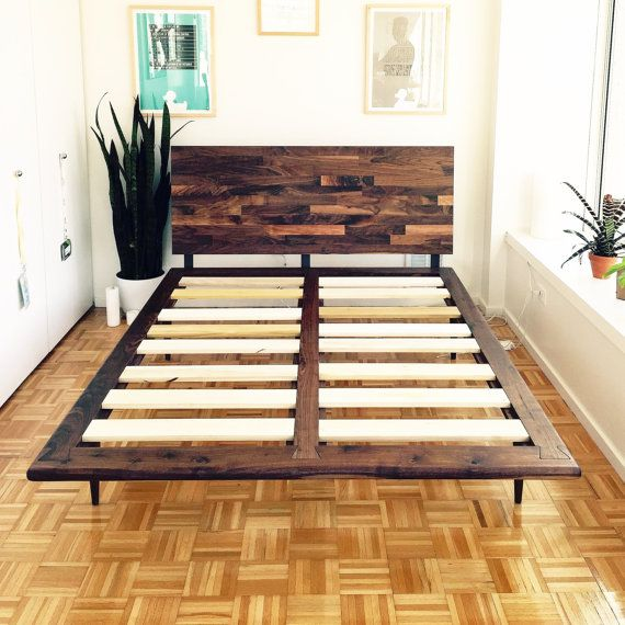 This minimalist bed is constructed with thick solid walnut planks with hand fitted dovetail joints that make the bed easy to assemble and extremely strong. The welded sleel brackets, stout hand turned mid century legs and mixed walnut head board finish this bed off with more