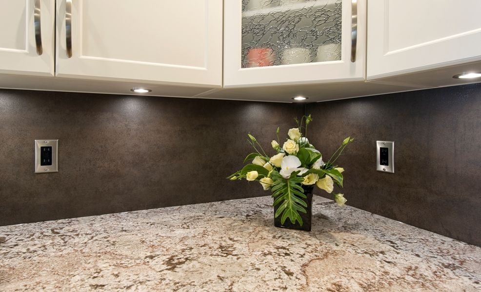 kitchen backsplash in iron copper neolith with bianco antico granite countertops cabinets by innovative kitchens