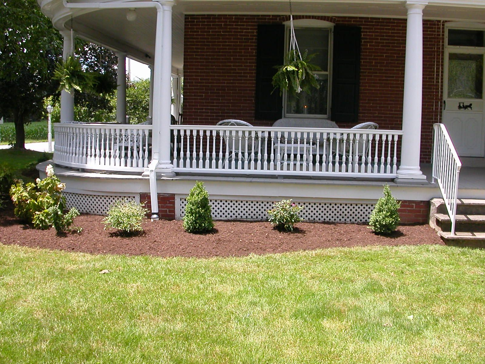 Landscaping ideas for wrap around porches our new for Small front porch landscaping ideas