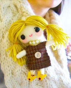 Blonde doll, just stick it to your sweater