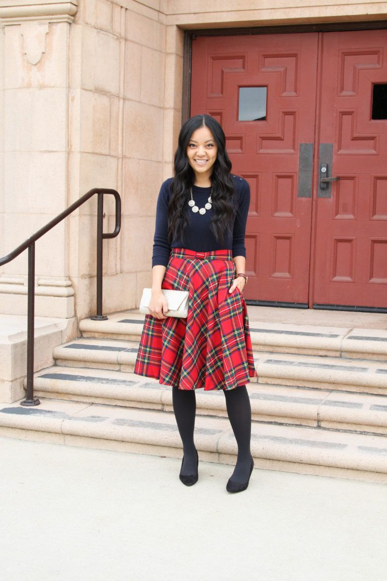 b26ab967dcbc2 Navy top+red plaid midi skirt+black tights+black pumps/ heels+gold clutch/  stament necklace. Fall Dressy up Outfit 2018