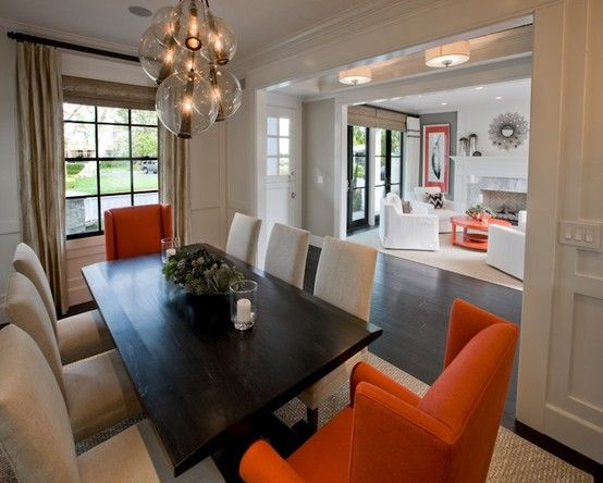 Gorgeous Modern Dining Room Design With Rectangular Wood Table Tan Linen Chairs Nailhead Trim Orange Wingback Captain And Brown