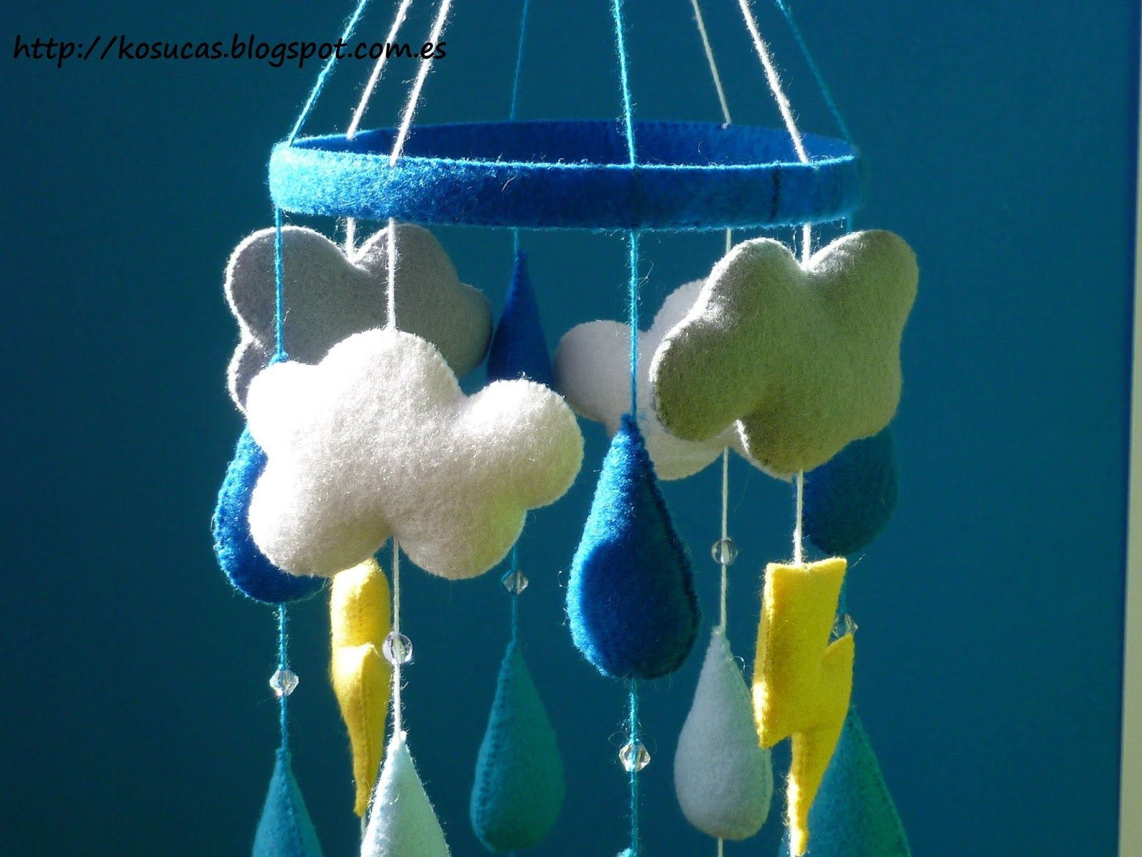 Felt weather baby mobile for the budding