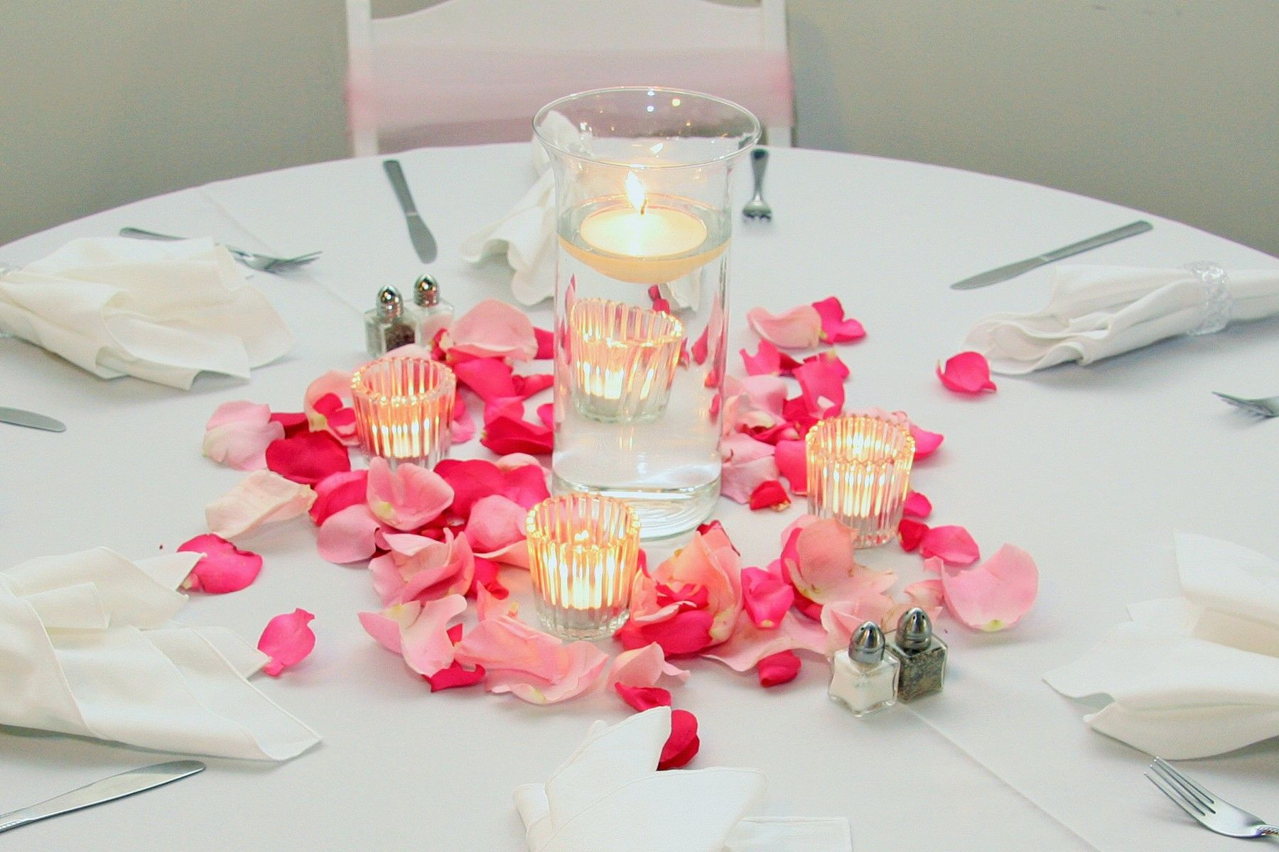 Glass cylinder vase wedding centerpiece with floating