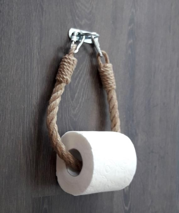 Photo of The toilet paper holder consists of natural jute rope and metal clips -…