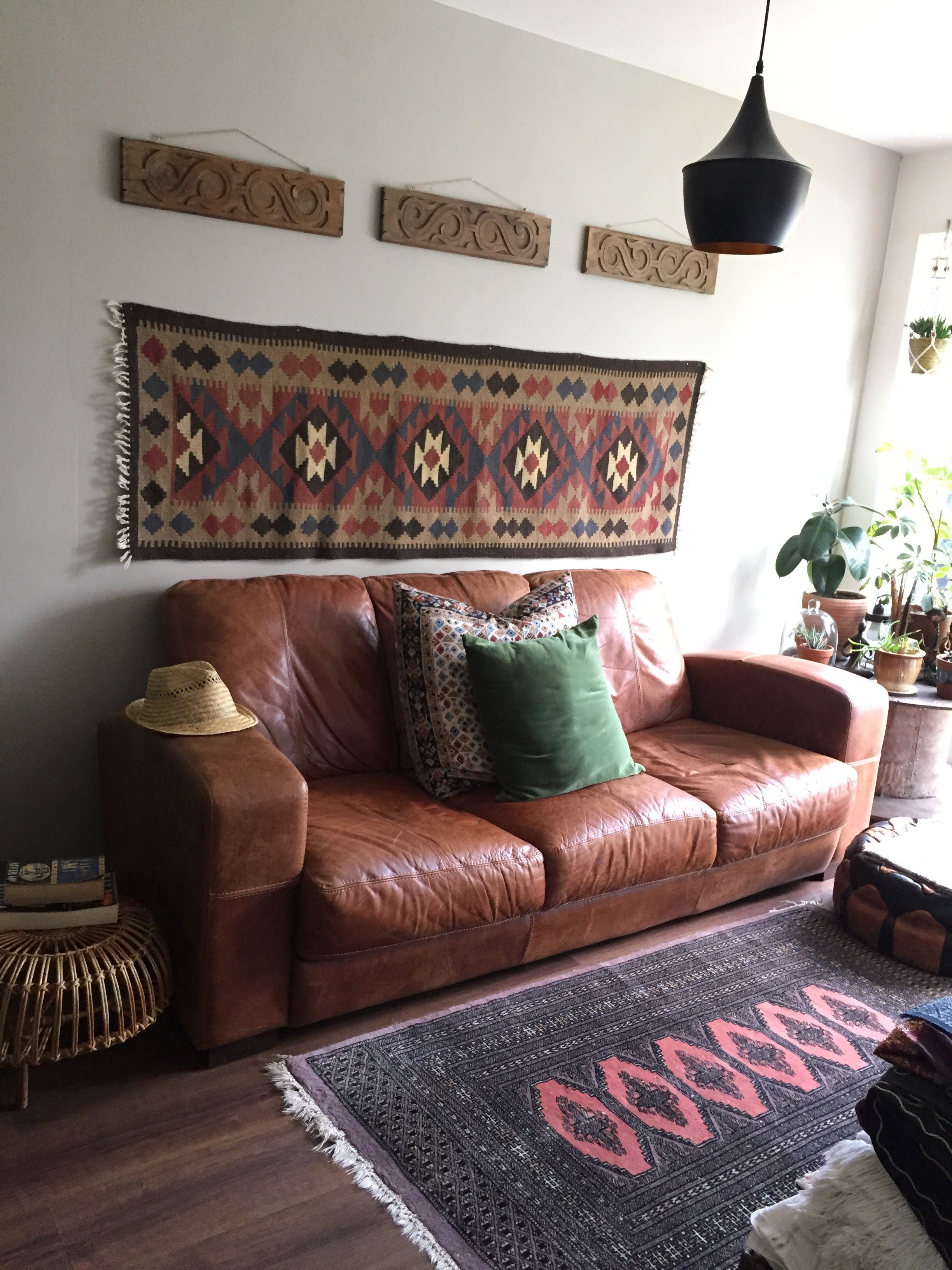 New sofa in our garden room   ve also hung one of my kilims on the wall some old carved panels found an antique shop and vintage persian rug