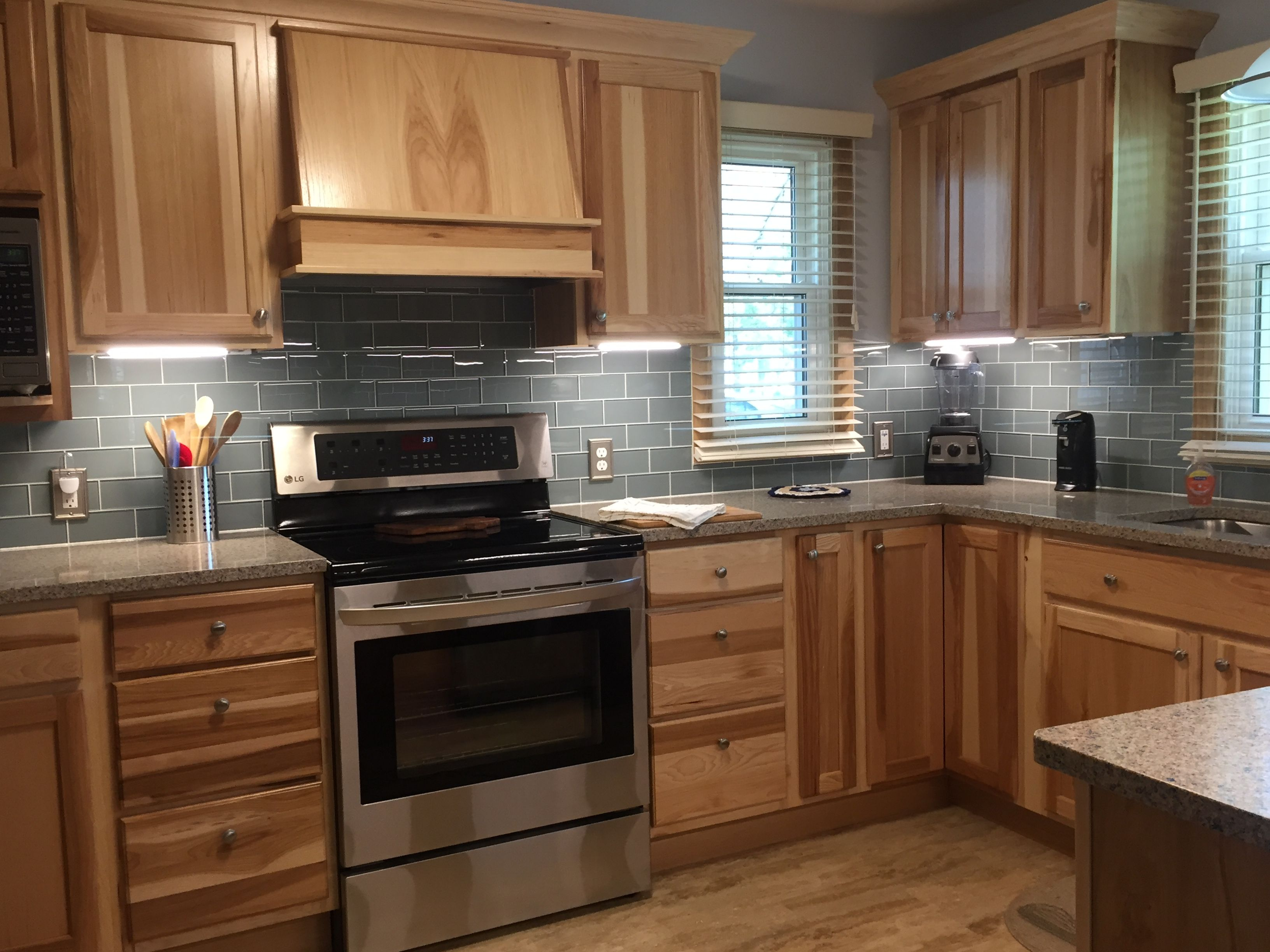 Hickory Cabinets And Range Hood With Smoky Blue Backsplash And Under Cabinet Lighting Hickory Cabinets Kitchen Backsplash Designs Small Kitchen Renovations