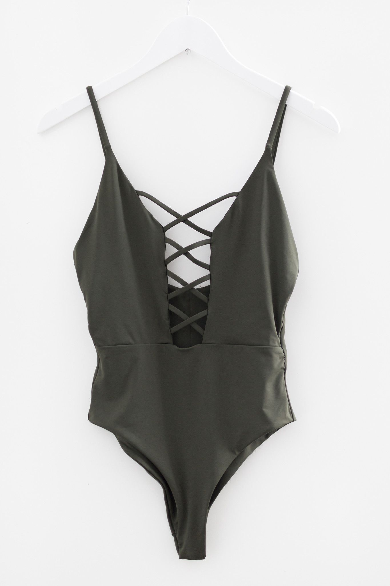 9109db8632b Seamless one piece swimsuit with a caged front. Cheeky fit with high leg cut  sides. Open square back with adjustable straps. Made and manufactured in  the ...