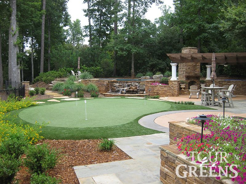 Corner putting green backyard design installed tour for Pool design course