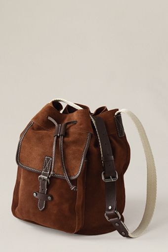 With all the travels during the Holiday season, you need a bag to keep all your necessities in! The suede bucket bag in chestnut suede is going to be the bag to keep up with your hectic pace no matter what you're stepping out in.