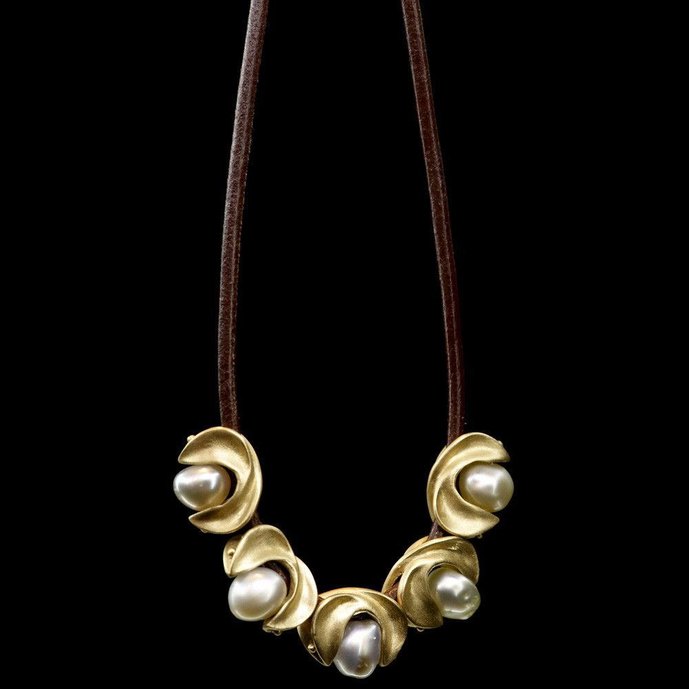 carrier beads. sculptural rosette shaped 10 karat gold carrier beads holding silvery keshi pearls and strung on leather