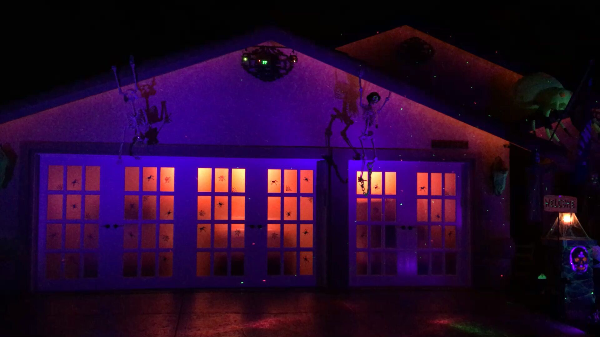 Our Frenchporte garage doors really let us add to the party with - Halloween Garage Door Decorations