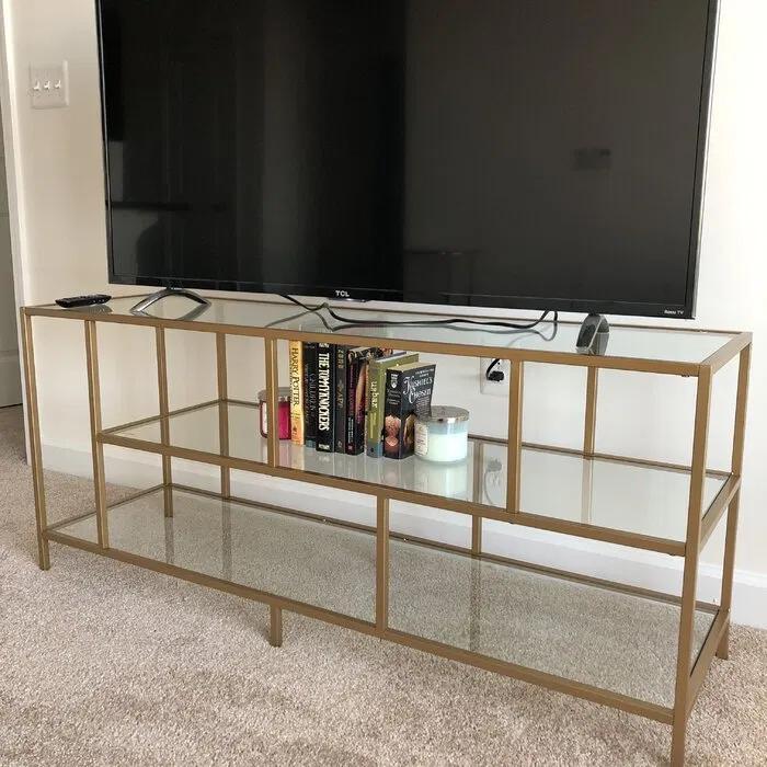 table tv en metal et verre en dore