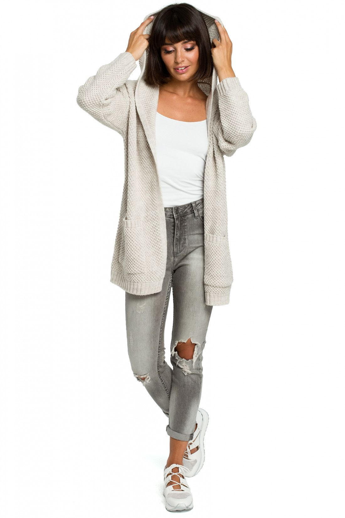 66f67b0e8 Price €38.50 Knitted cardigan with pockets and a hood. It s made of smooth  knitted