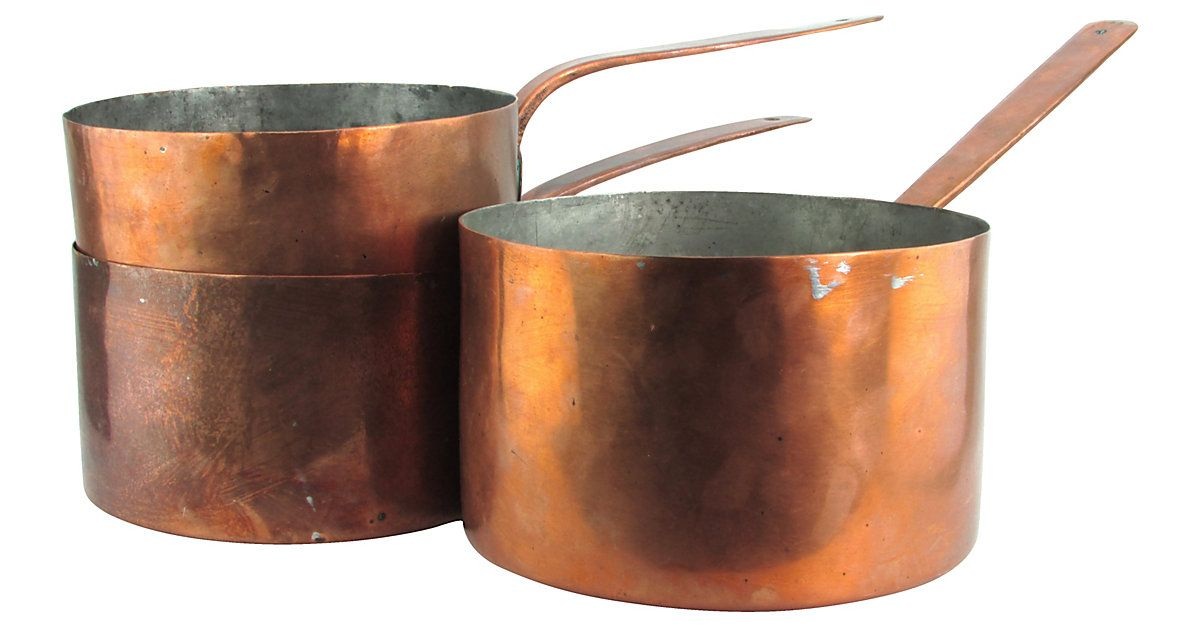 Set of three antique handmade copper sauce pots with braised
