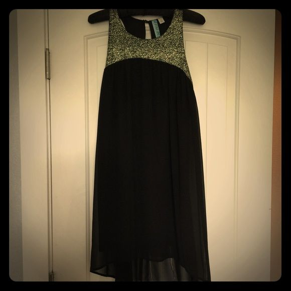 Black and Gold shift Shorter in the front and longer in the back.  This dress was worn once to a Gatsby party! Dresses