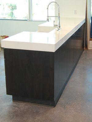 White concrete countertops on pinterest concrete for Polished concrete kitchen countertops