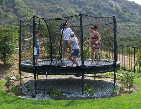 trampoline: rocks underneath with a little hedging ...
