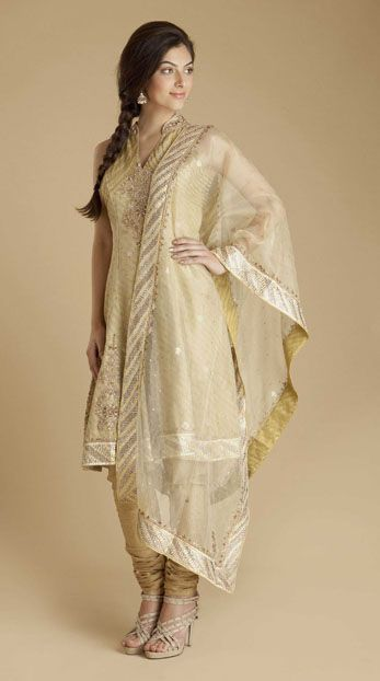 efd273b4ef Ritu Kumar Gold Banares silk stand collar kurta with zardozi embroidery,  lined in chanderi silk with zip closure. Paired with gold Banares silk  churidar ...
