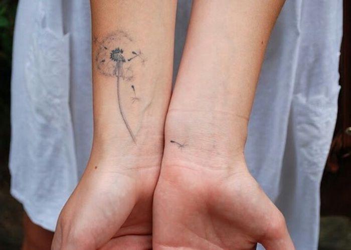 Frau pusteblume unterarm tattoo Pusteblume Tattoo