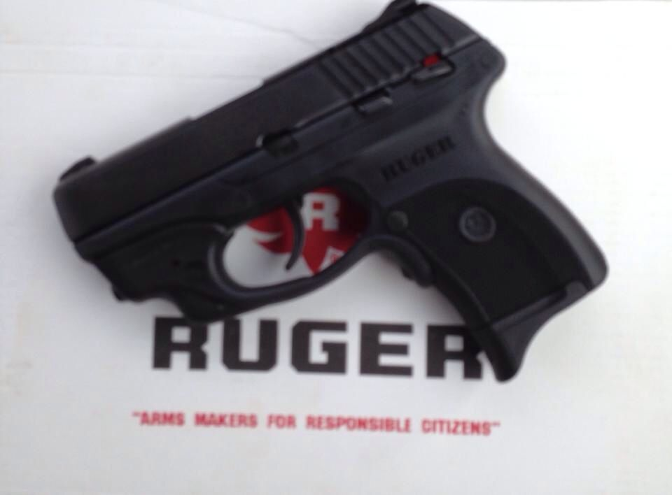 My wife's pick  Ruger LC9 with Crimson Trace laser 9mm
