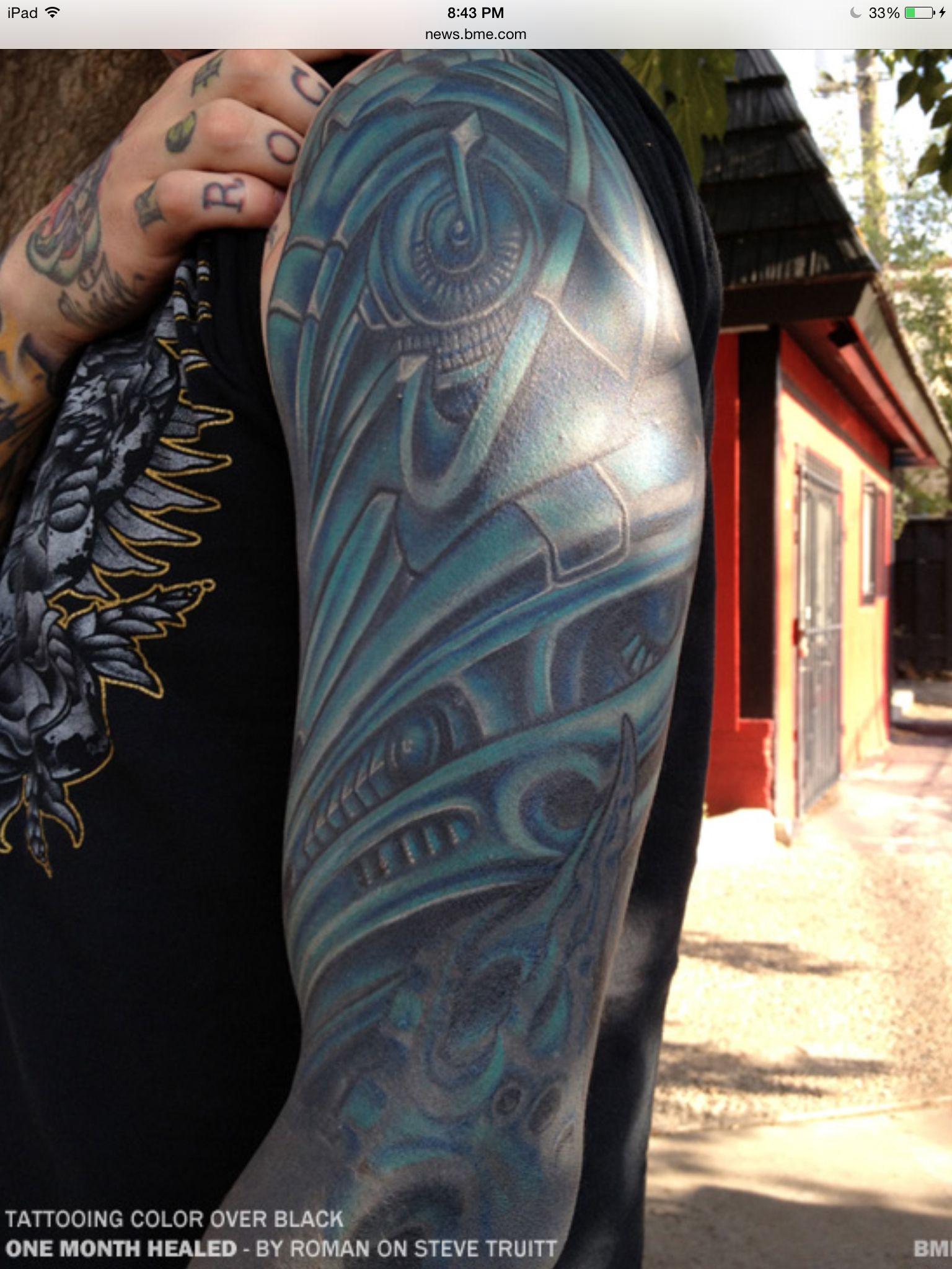 Roman Blue Over Solid Black No Laser Treatment Tattoo Ideas