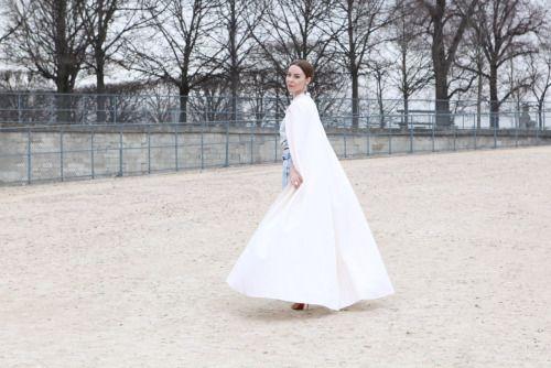 Ulyana Sergeenko in a white cape and denim