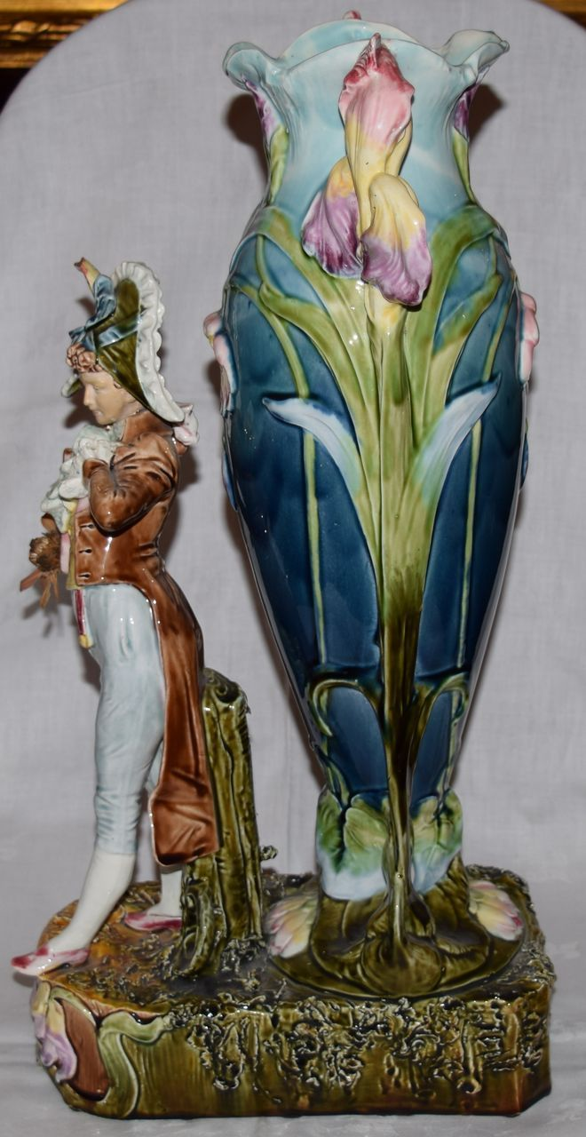 German Art Nouveau Majolica Vase. This vase features a male figure dressed in formal 18th century clothes. A stylized floral base supports the figure