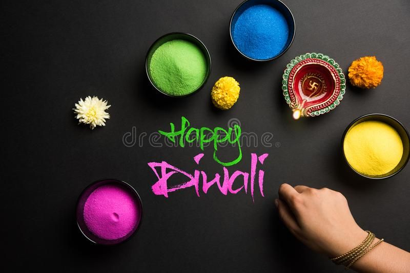 Happy Diwali Greeting Card Using Colourful Rangoli In Bowls, Diya Or Clay Lamp And Happy Diwali Writing With Flowers Stock Image - Image of kids, deepavali: 101850731