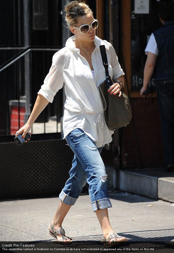 A mid length top and rolled up jeans does nothing for a long torso and short legs. For the legs to appear longer the cuffs have to go and the bum has to show...