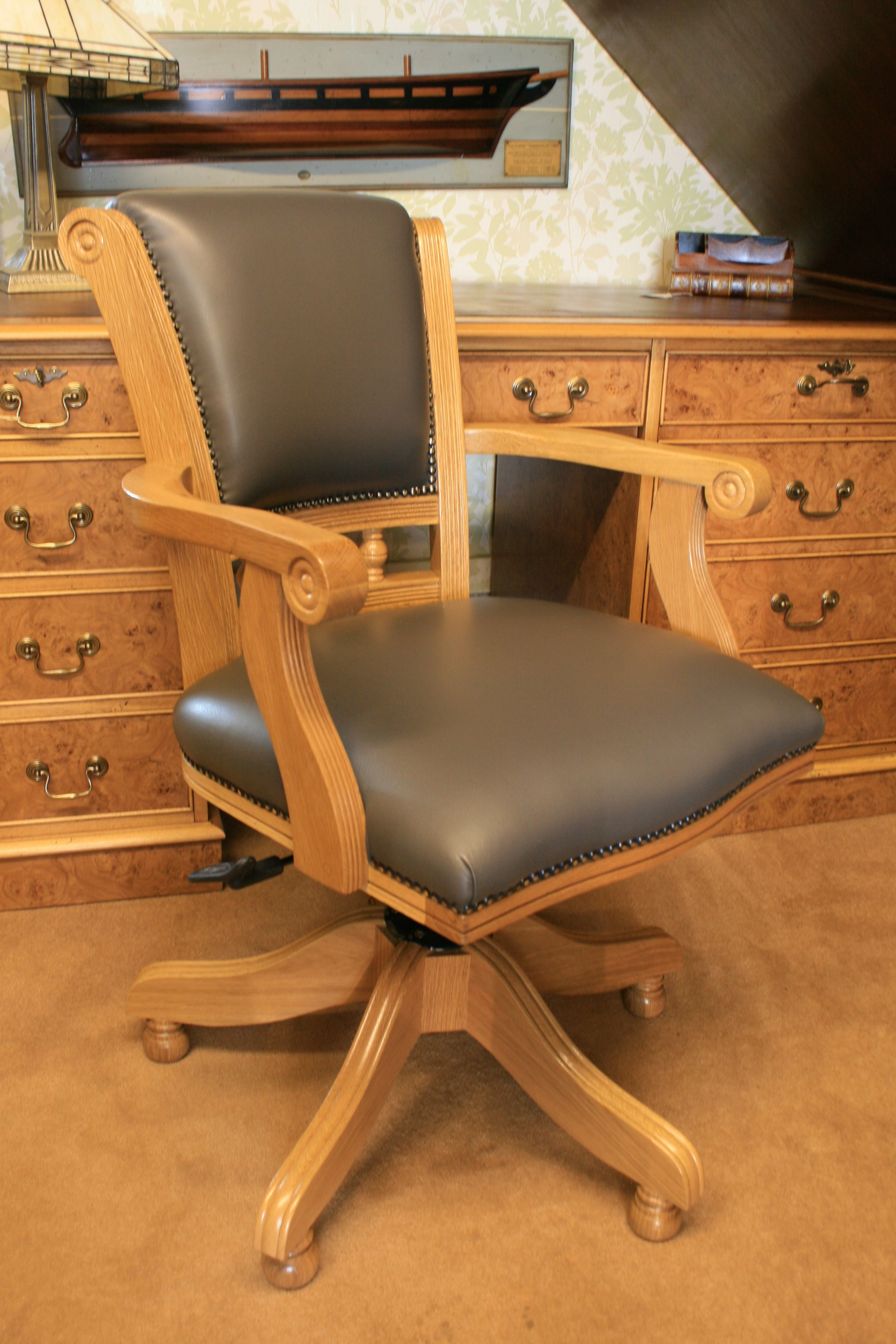 wooden swivel desk chair. A Viscount Swivel Desk Chair. Light Oak Frame With Special Order Pewter Grey Leather Upholstery. Turned Wooden Feet. Chair