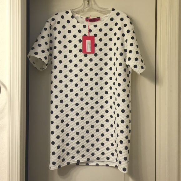 NWT Boohoo shift dress Super cute, white with polka dots. Light material with quilted pattern. I typically leave listings in my closet for about two weeks before donating (listed on 4/6), offers are always welcome, and I do a 25% bundle discount! No trades. Boohoo Dresses