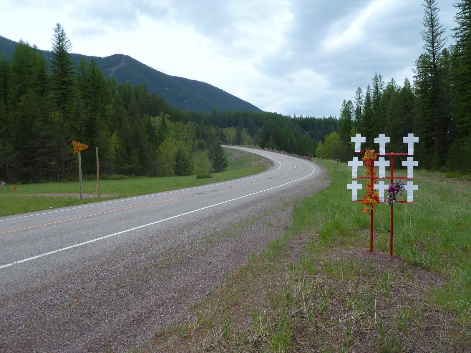 Essex?, Montana | the white roadside crosses each signify a traffic fatality in that spot. 9 in one accident.