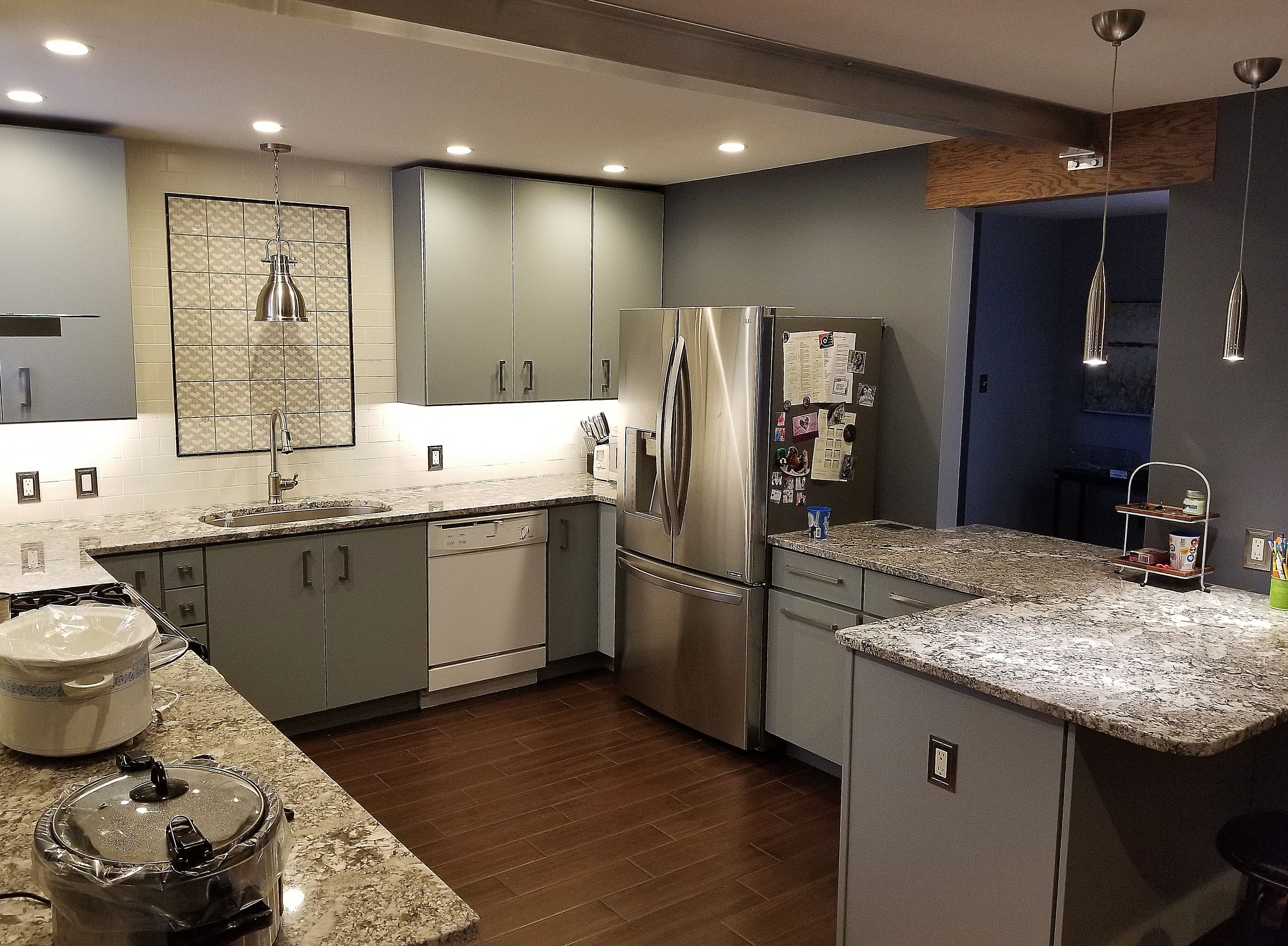 Contemporary kitchen with light blue cabinetry ganashe granite