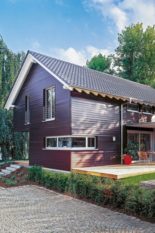 Photo of Schwedisches Haus mit dunkler Holzfassade – Beilharz Haus Avantgarde