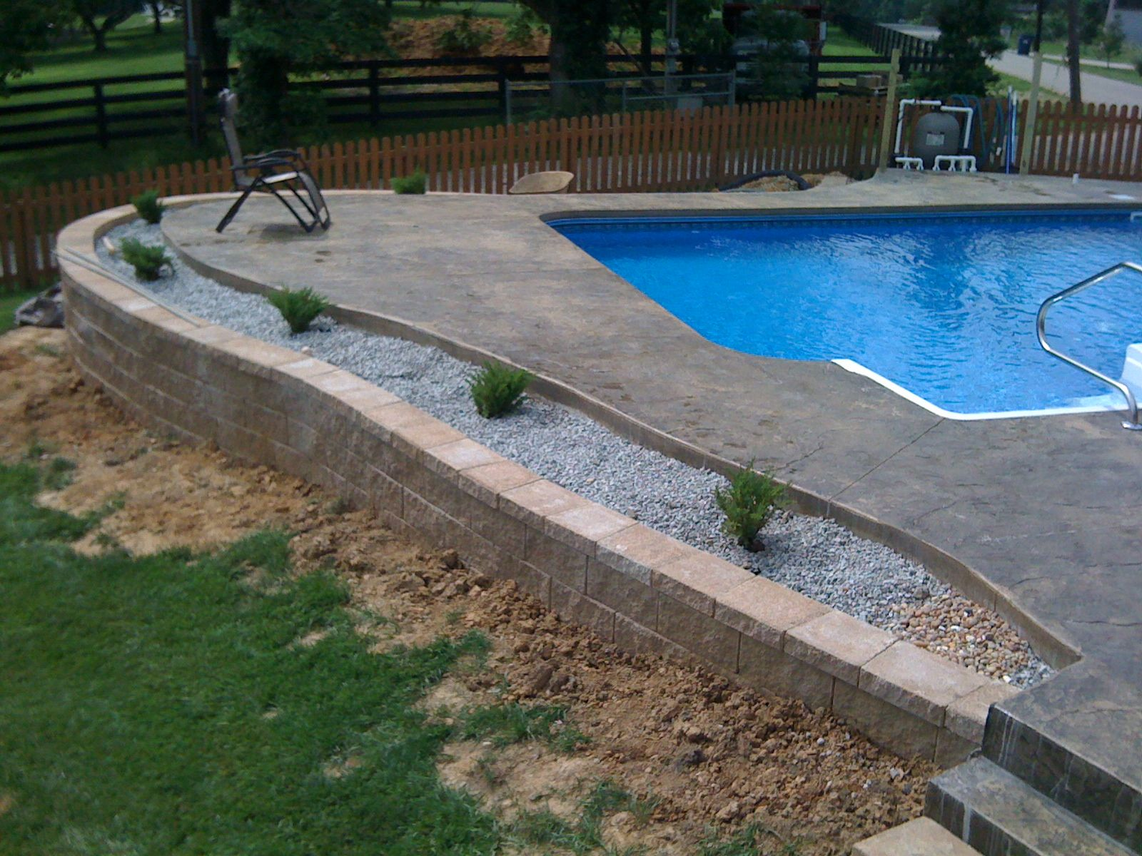 Backfilling Paver Pool Deck Inground Pool With Retaining Wall  An Inground Liner Pool With A